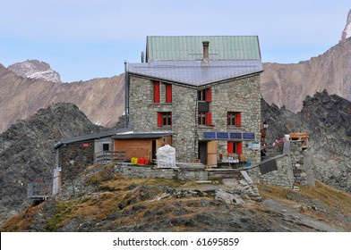 An isolated  mountain refuge in the european alps showing drinking water recovery,  and solar energy panels,