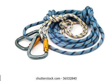 Isolated new climbing equipment - carabiners without scratches and blue rope