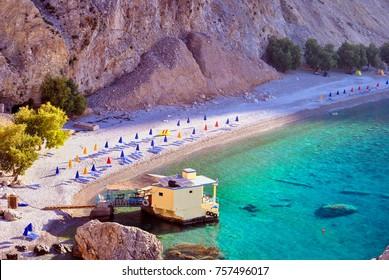 Isolated nudist beach called Glyka nera in South Crete Greece