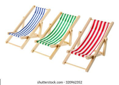 Isolated objects: group of wooden multicolored striped deck chairs, isolated on white background