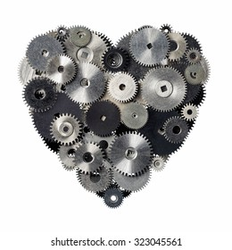 Isolated objects: heart shape made of metal pinions and sprockets, isolated on white background. Technical abstract for Valentines day or any other romantic event.