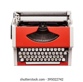 Isolated objects: little orange typewriter, view from above, on white background