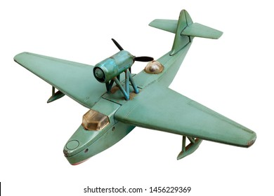Isolated objects: old generic hydro aeroplane green metal scale model, isolated on white background