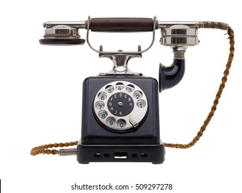 Isolated objects: one antique black telephone, very old and aged, isolated on white background