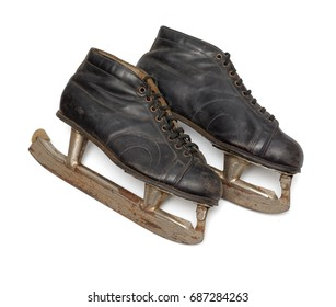 Isolated objects: pair of very old ice skates, on white background