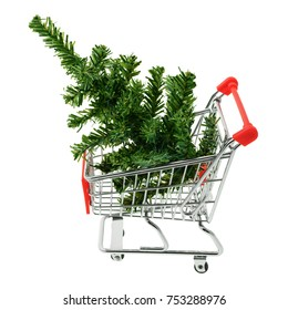 Isolated objects: toy Christmas tree in a shopping cart, on white background, seasonal shopping concept