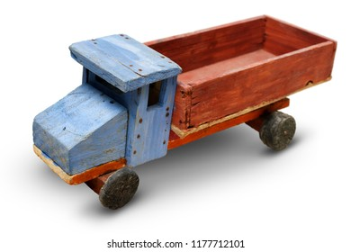 Isolated objects: very old handmade wooden toy, generic auto truck on white background, closeup shot