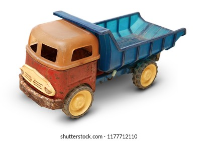 Isolated objects: very old plastic toy, generic auto truck on white background, closeup shot