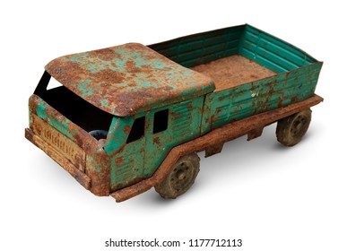 Isolated objects: very old tin toy, generic auto truck on white background, closeup shot