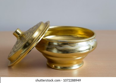 isolated old gold color copper kitchenware on the wooden background.