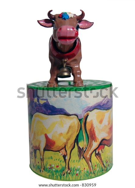 isolated old toy cow