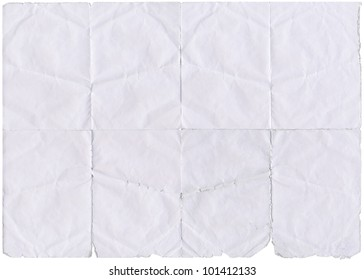 Isolated old white folded paper with torn edges.