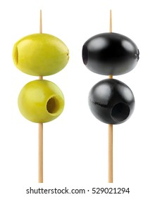 Isolated olives. Two green and two black pitted olive fruits on a wooden skewer isolated on white background with clipping path