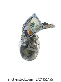 isolated on white background Dollars in a glass jar, symbol of the crisis, venality, wealth, hoarding