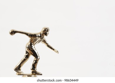 An isolated on white background gold bowling competition trophy.