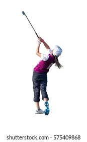 ISOLATED ON WHITE BACKGROUND / GOLF SWING BY A 9 YEARS OLD GIRL PLAYING IN JUNIOR LEAGUE GOLF / APPROACH SHOT FROM FAIRWAY WITH 8 IRON