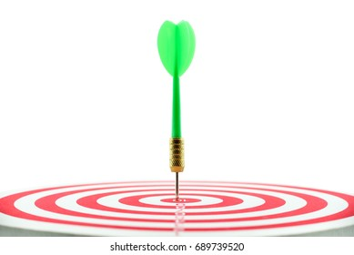 Isolated on white background : Green dart and a target or dart board, close up shot from side view. Dart and target are used in sport game but sometimes used in business, implies for business target.