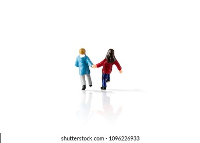 Isolated on white background image of miniature kids running. Clipping Path of the model included