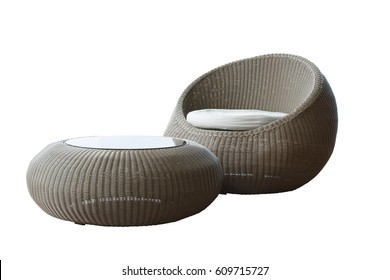 ISOLATED ON WHITE BACKGROUND OF A SET OF ROUND WICKER CHAIR WITH WHITE CUSHION AND COFFEE TABLE WITH MIRROR ON TOP