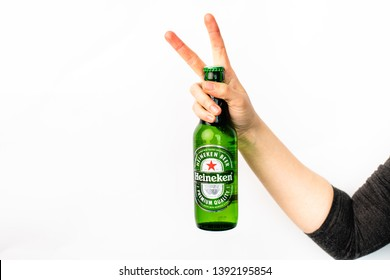 isolated on a white background, a woman's hand holding a bottle of Heineken's cold beer, Renningen,  Germany, 17.04.2019