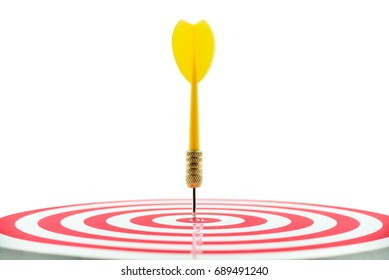Isolated on white background : Yellow dart and a target or dart board, close up shot from side view. Dart and target are used in sport game but sometimes used in business, implies for business target.