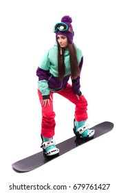 isolated on white, brunette attractive young caucasian woman in purple ski suit, blue boots and blue ski glasses ride snowboard, hands on knees