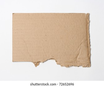isolated on white: close-up of ripped cardboard with copy space