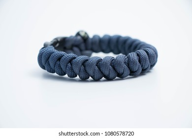 Isolated on white Single survival wristlet bracelet paracord knot