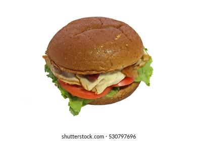 Isolated on white, turkey club sandwich, tomato, lettuce, bun.