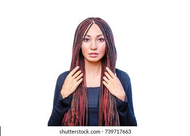 Isolated on white woman with colorful hair braided in thin plaits or dreadlocks in african style
