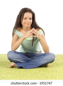 isolated on white young woman sitting on the green carpet