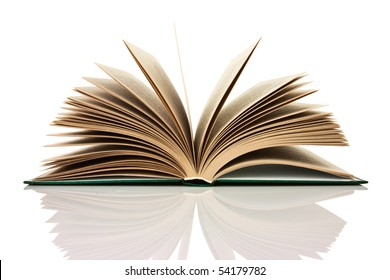 Isolated open book on the reflective surface of the table