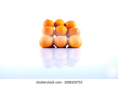 Isolated orange mandarin that is synonymous with the Chinese New Year celebration with shadow  in the white background