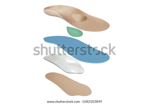 Isolated orthopedic insole on a white background. Treatment and prevention of flat feet and foot diseases. Foot care, comfort for the feet. Wear comfortable shoes. Medical insoles.