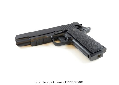 An isolated over white background of a hand gun pistol.