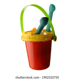 An isolated over white background image of a red sand bucket with various accessories like a sifter and shovel.