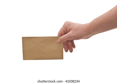 an isolated over white, caucasian man's hand holding a small brown mottled envelope