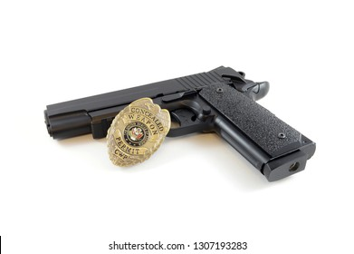 Isolated over white image of a police badge and handgun for law enforcement.