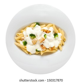 Isolated overhead shot of Penne Alfredo pasta. See more in gallery