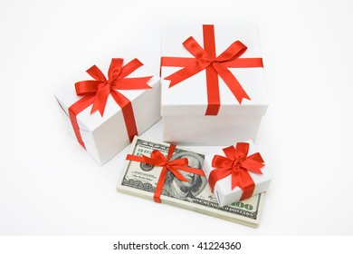 The isolated pack dollars lies among Christmas gifts