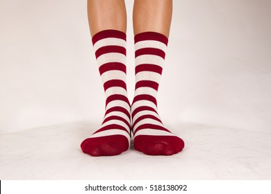 Isolated pair of striped white and red socks on white background