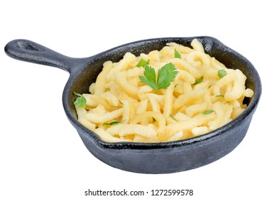 Isolated pan with spatzle with butter and parsley on white background