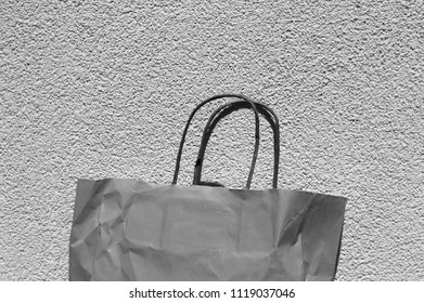 Isolated paper bag and wall background (Pesaro, Italy)