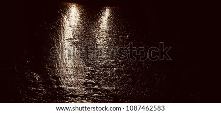An isolated part of a wet rainy concrete road unique background photograph