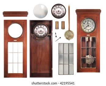 Isolated parts of an antique pendulum clock made of wood, glass and bronze