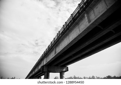 Isolated parts of a highway bridge unique black and white photo