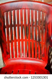 Isolated parts of a red plastic chair unique photo