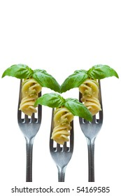 Isolated pasta and basil leaf on fork