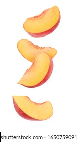 Isolated peach slices. Four wedges of raw peach fruits isolated on white background with clipping path