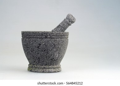Isolated pestle and mortar also known as 'ulekan dan cobek' are common kitchen utensils in Indonesia for 'sambal' making